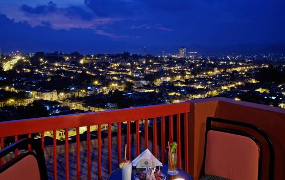 "Santiago de Cuba AS NIGHT FALLS, FROM THE ""BELLO BAR"" TERRACE"